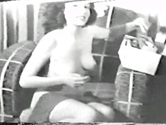 Vintage bikini models strip and show off their perky tits in black and white