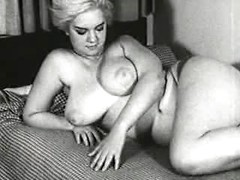 Chubby retro blonde unhooks her bra and releases her amazing huge tits