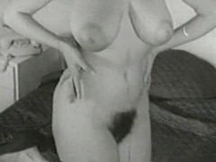 Retro pinup milf with huge natural tits and big areolas to go with her bush
