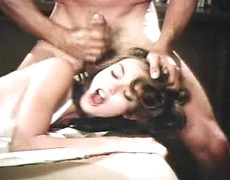 Retro beauty dressed in white shared by two guys in a vintage threesome scene