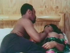 Big tits ebony babe with a hairy pussy is the subject of lust in a retro sex scene