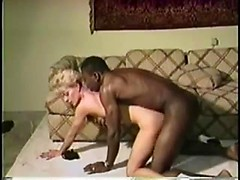 1980s wife with short blonde hair cheats with a massive black cock inside her