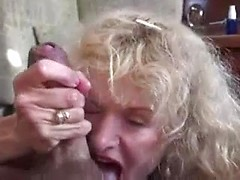 Big tits wife works over his dick with her mouth and hands until he cums hard